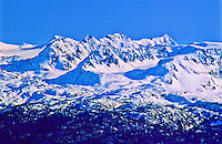 Snow covered Kenai Mountains as viewed from Homer, Alaska.  Kenai Peninsusla.