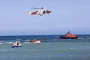 The Royal National Lifeboat Institution RNLI Dover Life boat 17-09,  HM Coastguard rescue helicopter G-C1JW  and the RNLI Inshore lifeboat - B-766 take part in a joint training exercise in in the sea outside Folkestone Harbour, Folkestone, Kent. UK. 6th August 2016