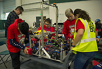 """The Gilford """"Screaming Eagles"""" team check over their robot before qualifying rounds during the Governor's Cup FirstNH Robotics Competition at All Well North/PSU on Saturday.  (Karen Bobotas/for the Laconia Daily Sun)"""