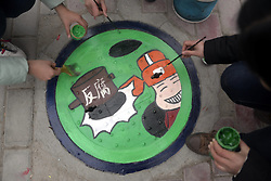 January 17, 2017 - Qingdao, Qingdao, China - Qingdao, CHINA-January 17 2017: (EDITORIAL USE ONLY. CHINA OUT) ..The colorful sewer cover in Liaocheng, east China's Shandong Province, January 17th, 2017. Volunteers from Liaocheng University painted creative cartoon patterns on sewer covers in Liaocheng, advocating environment protection and green lifestyle. (Credit Image: © SIPA Asia via ZUMA Wire)