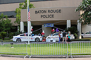 Makeshift memorial for officers slain by a lone gunman in Baton Rouge in front of the Baton Rouge Police station that has had barricades up since the Alton Sterling police brutality protests two weeks oago.