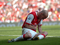 Photo: Tony Oudot.<br /> Arsenal v Bolton Wanderers. The Barclays Premiership. 14/04/2007.<br /> Freddie Ljungberg of Arsenal goes down clutching his chest