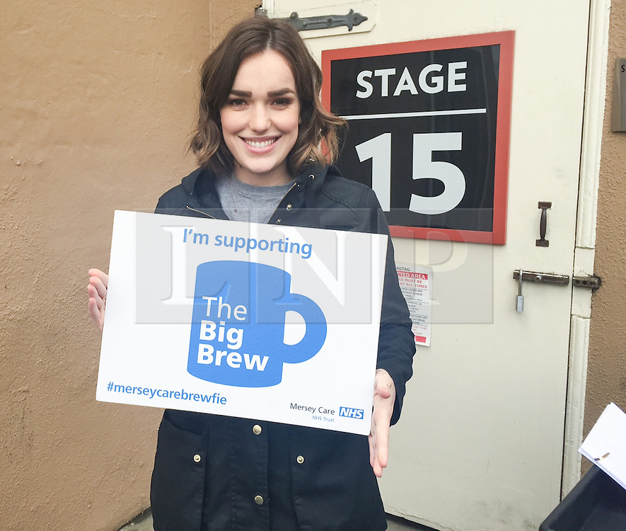 """© Licensed to London News Pictures . 19/01/2015 . Liverpool , UK . Elizabeth Henstridge from Agents of Shield . Celebrities pose with """" Big Brew """" placards in support of mental health awareness as today (19th January 2015) marks """" Blue Monday """" , the day regarded by many as the most depressing in the year . Campaigners are urging the public to show support by tweeting sefies with their favourite brew and the hashtag """" #brewfie """" . In London , Deputy Prime Minister Nick Clegg , is announcing his campaign to improve mental health awareness , reduce stigma and promote a """" zero ambition """" target for suicide . Photo credit : Joel Goodman/LNP"""