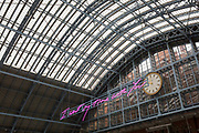 The new artwork entitled I Want My Time With You by British Britpop artist Tracy Emin hangs over the main concourse at St. Pancras Station, on 10th April 2018, in London, England. In the sixth year of the Terrace Wires Commission - and in celebration of the 150th anniversary of St Pancras International and the 250th anniversary of the Royal Academy of Arts, at one of Londons mainline station, the London hub for Eurostar - the 20 metre-long greeting to commuters reads I Want My Time With You and Emin thinks that arriving by train and being met by a lover as they put their arms around them, is very romantic. The Brexit-opposing artist also said she wanted to make a statement that reaches out to everybody from Europe arriving in to London.