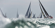 Yachts racing at the start of the 90th anniversary Rolex Fastnet Race on the Solent. A record fleet of 370 yachts will compete to win the Fastnet Challenge Cup.<br /> The 600 nautical mile race starts in Cowes, Isle of Wight, heading to the Fastnet Rock off the south west coast of Ireland and finishes in Plymouth.<br /> It is the world's biggest offshore race with 75% amateur sailors and professional yachtsmen competing against each other. <br /> Picture date Sunday 16th August, 2015.<br /> Picture by Christopher Ison. Contact +447544 044177 chris@christopherison.com