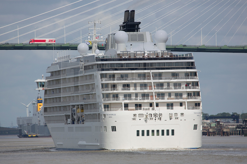 © Licensed to London News Pictures. 03/07/2016. The World approaches the QEII Bridge at Dartford. The World residential cruise ship has arrived in Greenwich, London. MS The World is a residence at sea, carrying wealthy passengers around the world who own apartments on board. The ship, which was launched in 2002, has 165 apartments.  As well as six restaurants, the World has a large lobby, gourmet deli and grocery store, a boutique and showroom, fitness center, billiard room, golf simulator and putting greens, a full-sized tennis court, jogging track, a spa, swimming pool, and cocktail lounge. The World last visited London in 2013. Credit: Rob Powell/LNP