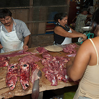 Merchants sell beef in an outdoor market in upper Belem, a crowded neighborhood in Iquitos, Peru.