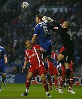 Photo: Steve Bond/Richard Lane Photography. Leicester City v Leyton Orient. Coca Cola League One. 10/01/2009. Keeper Glen Morris punches clear as Steve Howard jumps