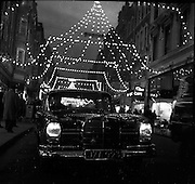 05/12/1960<br /> 12/05/1960<br /> 05 December 1960<br /> Mercedes car under Christmas lights on Grafton Street, Dublin.