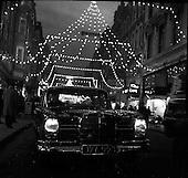 1960 - Mercedes car under Christmas lights on Grafton Street
