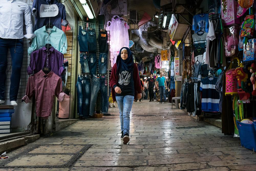 A girl walks through the Old City, Jerusalem.