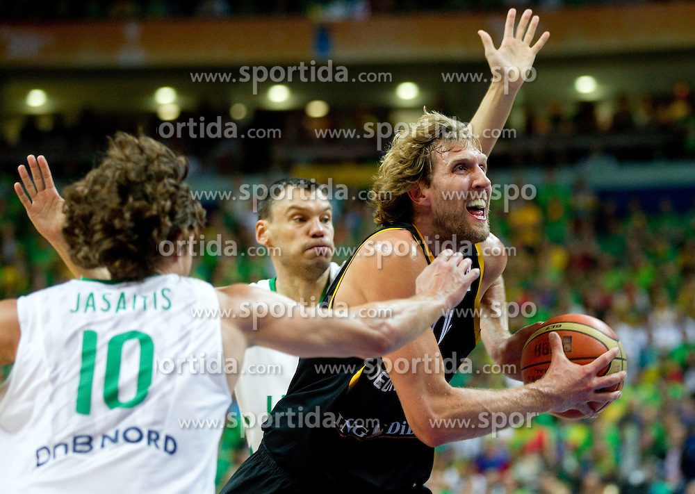 Dirk Nowitzki of Germany between Simas Jasaitis of Lithuania and Sarunas Jasikevicius of Lithuania during basketball game between National basketball teams of Lithuania and Germany at FIBA Europe Eurobasket Lithuania 2011, on September 11, 2011, in Siemens Arena,  Vilnius, Lithuania. (Photo by Vid Ponikvar / Sportida)