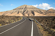Road leading towards Montana de Medio,  mountain, Los Ajaches mountain range, Lanzarote, Canary Islands, Spain