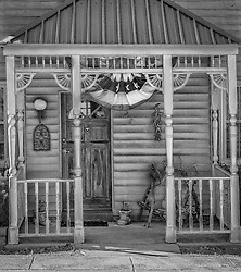This quaint front porch scene in New Melle, Missouri always reminds me of my Grandmother's house and the small town rural feel. Good memories!
