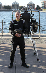 David Mayman, alongside the JB-10 Jetpack flying machine at the Royal Victoria Docks in east London on its maiden flight in the UK to mark the launch of an equity crowdfunding campaign on Seedrs.