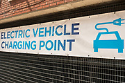 Sign for electric charging points on 14th June 2021 in Birmingham, United Kingdom. An electric car is an automobile that is propelled by one or more electric motors, using electrical energy stored in rechargeable batteries or another energy storage device. The resulting drop in harmful emissions makes eco cars an ecologically sound alternative to regular fuel cars.