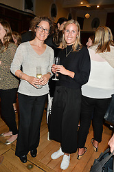 Left to right, LOUISE CARTLEDGE and TAMARA LANCASTER at a party to celebrate the publication of English Houses by Ben Pentreath held at the Art Worker's Guild, 6 Queen Square, London on 28th September 2016.