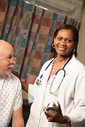 Healthcare Nurse With A Patient