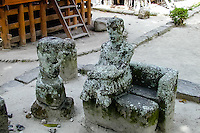 Indonesia, Sumatra. Samosir. The famous stone chairs in Ambarita. Criminals were also tried here, and on numerous occasions got a death penalty. Both the King and the medicine man was then present, the people gathered in the background.