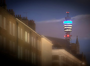 BT Tower at night with london town houses in the foreground