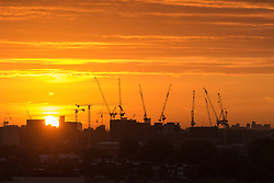 Primrose Hill, London, September 27th 2016. The sun rises over east London revealing the silhouettes of tower cranes, viewed from Primrose Hill as dawn breaks over the city. ©Paul Davey<br /> FOR LICENCING CONTACT: Paul Davey +44 (0) 7966 016 296 paul@pauldaveycreative.co.uk
