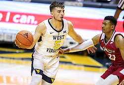 Nov 28, 2018; Morgantown, WV, USA; West Virginia Mountaineers guard Jordan McCabe (5) dribbles the ball during the first half against the Rider Broncs at WVU Coliseum. Mandatory Credit: Ben Queen-USA TODAY Sports