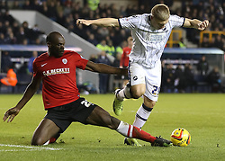 Barnsley's Kelvin Etuhu tackles Millwall's Martyn Waghorn in the box - Photo mandatory by-line: Robin White/JMP - Tel: Mobile: 07966 386802 23/11/2013 - SPORT - Football - Millwall - The Den - Millwall v Barnsley - Sky Bet Championship