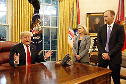 October 10, 2018 - Washington, District of Columbia, U.S. - United States President DONALD TRUMP, left, meets with Federal Emergency Management Agency (FEMA) Director William Brock Long, right, and US Secretary of Homeland Security (DHS) Kirstjen Nielsen, center, on Hurricane Michael in the Oval Office of the White House. (Credit Image: © Martin H. Simon/CNP via ZUMA Wire)