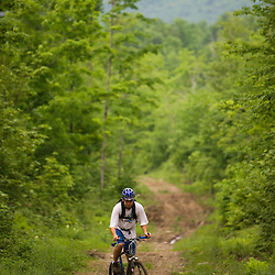 Mountain biking on a logging road in Granby, Vermont, near Nurse Mountain.  The Northeast Kingdom.