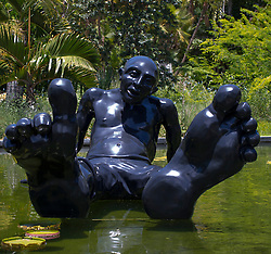 comical statue with large feet