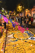 People stop to view Dead of the Dead altars known as an ofrendas honoring deceased relatives during the Dia de Muertos festival in San Miguel de Allende, Mexico. The multi-day festival is to remember friends and family members who have died using calaveras, aztec marigolds, alfeniques, papel picado and the favorite foods and beverages of the departed.