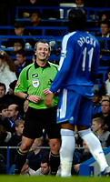 Photo: Ed Godden/Sportsbeat Images.<br />Chelsea v Wigan Athletic. The Barclays Premiership. 13/01/2007. Referee Martin Atkinson has a laugh with Chelsea's Didier Drogba.