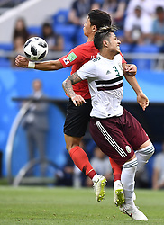 ROSTOV-ON-DON, June 23, 2018  Hwang Heechan (L) of South Korea handles the ball during the 2018 FIFA World Cup Group F match between South Korea and Mexico in Rostov-on-Don, Russia, June 23, 2018. Mexico won 2-1. (Credit Image: © Chen Yichen/Xinhua via ZUMA Wire)