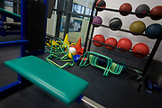 Gym equipment at the Sports Institute, University of Ulster, Northern Ireland. Weight balls rest on a rack by a wall and miscellaneous equipment to help the trainer's exercises. Sports Institute Northern Ireland (SINI) was set up in 2002 as the catalyst for establishing the high performance sporting system in Northern Ireland. SINI is designed to provide high level support to Northern Ireland's top athletes and coaches across a range of Olympic, Paralympic and Commonwealth Games sports along with a select number of sports that are important to the public in Northern Ireland including rugby, soccer, cricket, GAA, golf and motor sports. SINI is a partnership between Sport Northern Ireland and the University of Ulster and is based on the Jordanstown campus of the University of Ulster.
