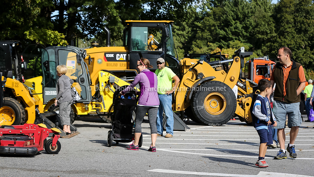 (9/26/15, WAYLAND, MA) People check out the trucks during the Touch-a-Truck event at Wayland Middle School on Saturday. Daily News and Wicked Local Photo/Dan Holmes