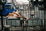 A worker naps on his bike at the wholesale market in Luo Yang, China.