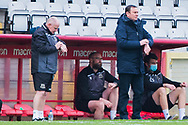 Morecambe manager Derek Adams and Morecambe assistant manager John Mcmahon during the EFL Sky Bet League 2 match between Stevenage and Morecambe at the Lamex Stadium, Stevenage, England on 6 February 2021.