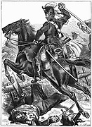 Franco-Prussian War 1870-1871: Prussian Hussar charging with sword drawn. Wood engraving.