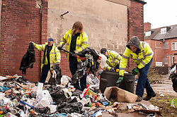 Council workers clearing refuse in an area of social deprivation in Goldthorpe, South Yorkshire due to absent landlord tenacy agreements