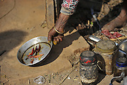 Dec. 29, 2015 - Kathmandu, NP, Nepal -<br /> <br /> Earthquake Survivors struggling in temporary Tent on Winter Season<br /> <br /> A hand of ASTA MAYA MAHARJAN, 75yrs, an earthquake survivor roast red chilies for making spice outside the temporary tent on 29 December, 2015 at Panga, Kirtipur, Kathmandu, Nepal. Most of houses in Panga, Kirtipur were destroyed by recent earthquake on April 25, 2015, a magnitude of 7.8 earthquake killing over 8,000 of people in Nepal and thousands of injured, which Outcomes Hundreds of people were homeless with entire villages across many districts of the country. <br /> ©Exclusivepix Media