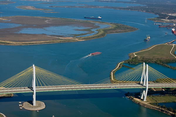 Afternoon aerial view of the Fred Hartman Bridge over the ship channel at the Port of Houston.