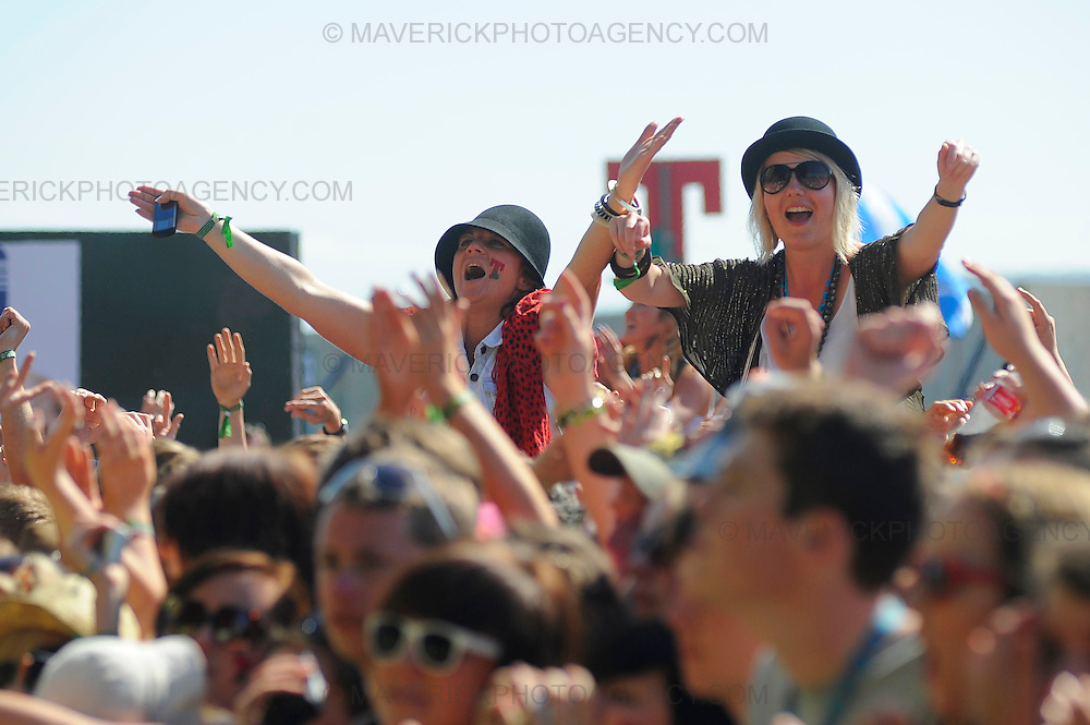 Revellers enjoy the sunshine at T in the Park music festival in Kinross, Perthshire - 11th July 2009.  Pictured fans watch Paolo Nutini.