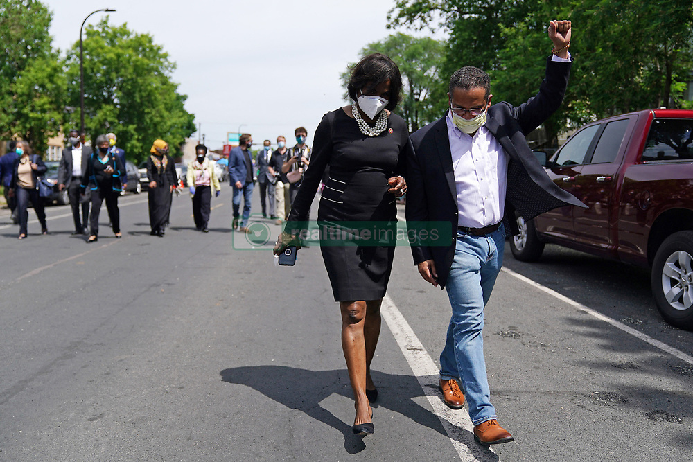 Sate Attorney General Keith Ellison pumps his fist to cheers from onlookers after he and members of the United States Congressional Black Caucus visit the site of George Floyd's death, Thursday, June 4, 2020, in Minneapolis. Photo by Anthony Souffle/Minneapolis Star Tribune/TNS/ABACAPRESS.COM