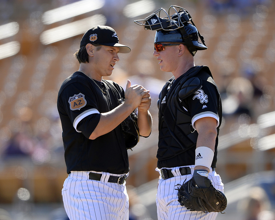 GLENDALE, ARIZONA - MARCH 06:  Zach Collins #86 speaks with Jace Fry #80 of the Chicago White Sox during a spring training game against the San Diego Padres on March 6, 2017 at Camelback Ranch in Glendale Arizona.  (Photo by Ron Vesely)   Subject:   Zach Collins; Jace Fry