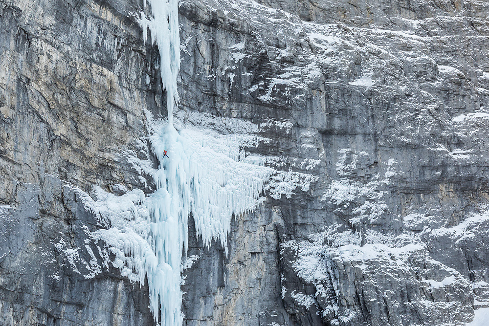 Stas Beskin ice climbing the rarely formed full ice pitch on the Real Big Drip in the South Ghost