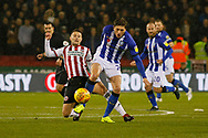 Sheffield Wednesday midfielder Adam Reach (20) goes pastSheffield United midfielder Oliver Norwood (16)  during the EFL Sky Bet Championship match between Sheffield United and Sheffield Wednesday at Bramall Lane, Sheffield, England on 9 November 2018.