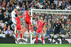 May 2, 2018 - Madrid, Spain - MADRID, SPAIN. May 1, 2018 - Sergio Ramos jumps for the ball. With a 2-2 draw against Bayern Munchen, Real Madrid made it to the UEFA Champions League Final for third time in a row. Kimmich and James scored for the german squad while Karim Benzema did it twice for los blancos. Goalkeeper Keylor Navas had a great night with several decisive interventions. (Credit Image: © VW Pics via ZUMA Wire)