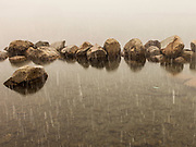 Convict Lake, Eastern Sierras.  Zen boulders and first snow at the outlet.
