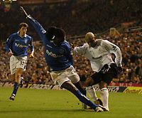 Photo. Glyn Thomas, Digitalsport<br /> Birmingham City v Bolton Wanderers.<br /> Barclays Premiership. 04/01/2005.<br /> Bolton's goalscorer El-Hadji Diouf (R) is thwarted by Mario Melchiot.