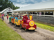 27 JUNE 2019 - CENTRAL CITY, IOWA: A toy train takes people around the fairgrounds at the Linn County Fair. Summer is county fair season in Iowa. Most of Iowa's 99 counties host their county fairs before the Iowa State Fair, August 8-18 this year. The Linn County Fair runs June 26 - 30. The first county fair in Linn County was in 1855. The fair provides opportunities for 4-H members, FFA members and the youth of Linn County to showcase their accomplishments and talents and provide activities, entertainment and learning opportunities to the diverse citizens of Linn County and guests.      PHOTO BY JACK KURTZ
